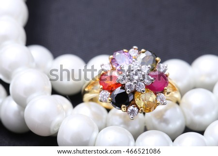 Ring with different color gemstone