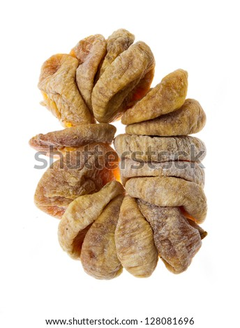 Ring with dried fig fruit on white background - stock photo