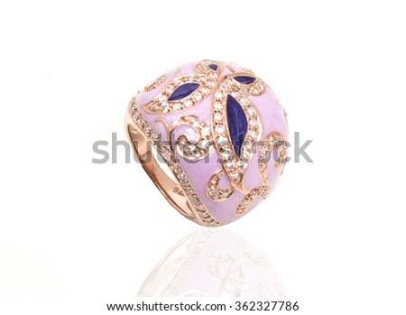Ring with gems and enamel isolated on white - stock photo