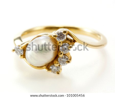 ring with pearl and diamond isolated on white