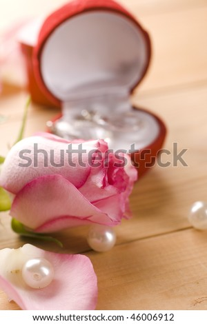 rings and pink roses