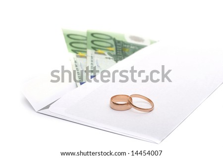 Rings, money and an envelope to a white background