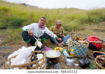 RINJANI MOUNTAIN, LOMBOK, INDONESIA-SEPT 18,2016: Unidentified mountain porters prepare food for trekkers on their way climb Rinjani Mountain in Lombok, Indonesia.