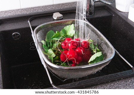 Rinse fresh vegetables in the sink with water