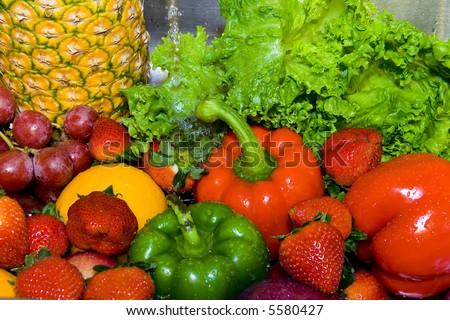 Rinsing fruits - stock photo