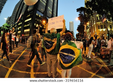 Rio Branco Avenue, downtown Rio de Janeiro - July 11, 2013: Holding banners, citizens protest against violence in Brazil. - stock photo