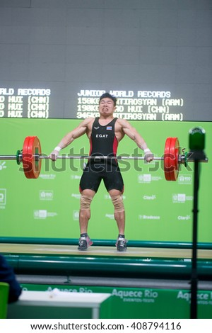 Rio, Brazil - April 4, 2016: KANGKEEREE Wattana (THA) in the male category during the Aquece Rio Weightlifting Test Event at the Arena Carioca 1