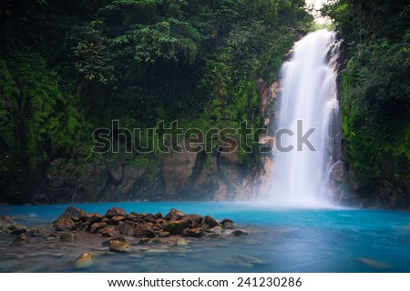Rio Celeste waterfall in Tenorio Volcano national park, Costa Rica. - stock photo