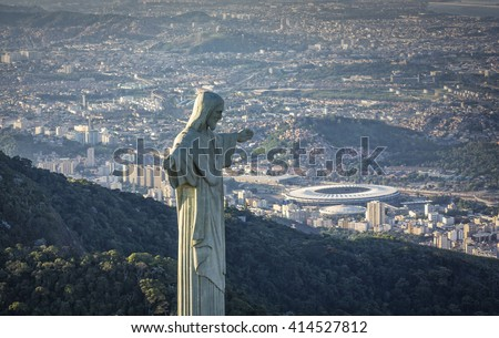 RIO DE JANEIRO, BRAZIL - CIRCA FEBRUARY 2016: Aerial view of Christ The Reedemer Statue looking at Maracana Stadium.  - stock photo