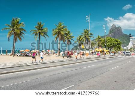 RIO DE JANEIRO, BRAZIL - CIRCA FEBRUARY  2016: People enjoying the sun on iconic Ipanema Beach in Rio de Janeiro. Rio will host 2016 Summer Olympic Games. - stock photo