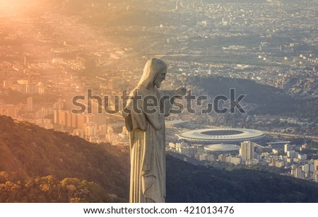 RIO DE JANEIRO, BRAZIL - FEBRUARY 2016: Aerial view of Christ The Reedemer Statue looking at Maracana Stadium. Opening and closing of 2016 Olympic Games will be held at Maracana Stadium.
