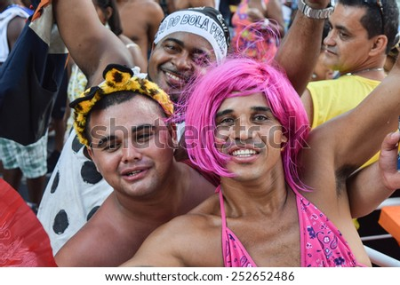 RIO DE JANEIRO, BRAZIL - FEBRUARY 14, 2015: Revellers in costumes take over the streets in one of Rio's largest carnival street bands. - stock photo