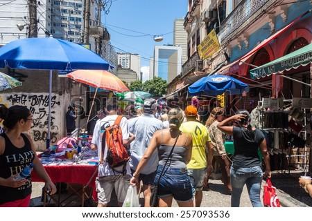 RIO DE JANEIRO, BRAZIL - JANUARY 28, 2015: People walk on a street in downtown of Rio de Janeiro, Brazil - stock photo
