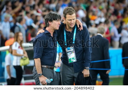 RIO DE JANEIRO, BRAZIL - July 13, 2014: Coach Joachim Loew of Germany celebrates after winning the 2014 World Cup Final at Maracana Stadiumand becoming  the Champions of The World. NO USE IN BRAZIL. - stock photo