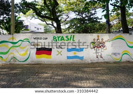 RIO DE JANEIRO, BRAZIL -25 JULY 2015- Graffiti street art murals representing the 2014 World Cup soccer (football) in Rio de Janeiro, Brazil - stock photo