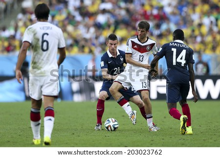 RIO DE JANEIRO, BRAZIL-July 04, 2014: Laurent KOSCIELNY of France and Thomas MUELLER of Germany compete for the ball during the World Cup round of 8 game between France and Germany at Maracana Stadium