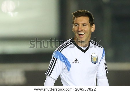 RIO DE JANEIRO, BRAZIL - JULY 12, 2014: Lionel Messi of Argentina during a training session in the San Januario stadium a day ahead of the World Cup final. NO USE IN BRAZIL. - stock photo
