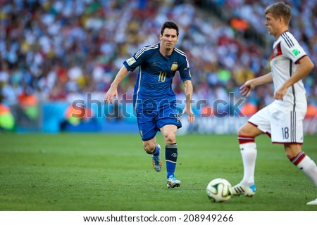 RIO DE JANEIRO, BRAZIL - July 13, 2014: Messi of Argentina and Kroos of Germany during the World Cup Final game between Argentina and Germany at Maracana Stadium. NO USE IN BRAZIL.