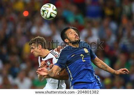 RIO DE JANEIRO, BRAZIL - July 13, 2014: Muller of Germany and Garay of Argentina during the 2014 World Cup Final game between Argentina and Germany at Maracana Stadium. NO USE IN BRAZIL.