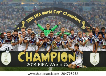 RIO DE JANEIRO, BRAZIL - July 13, 2014: Players of Germany celebrate with the Trophy after winning the 2014 World Cup Final game between Germany and Argentina at Maracana Stadium. NO USE IN BRAZIL. - stock photo