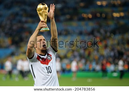 RIO DE JANEIRO, BRAZIL - July 13, 2014: Podolski of Germany celebrate with the Trophy winning the 2014 World Cup Final game between Argentina and Germany at Maracana Stadium. NO USE IN BRAZIL. - stock photo