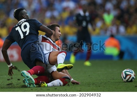 RIO DE JANEIRO, BRAZIL - JULY 04, 2014: Pogba of France and Goetze of Germany during the World Cup Quarter-finals game between France and Germany in the Estadio Maracana. NO USE IN BRAZIL.