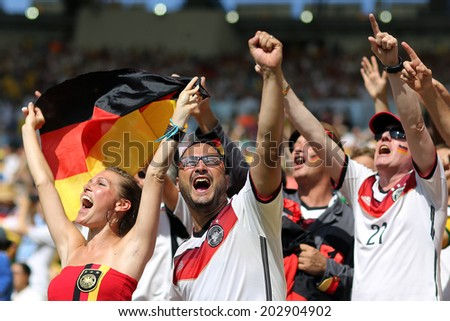 RIO DE JANEIRO, BRAZIL - JULY 04, 2014: Soccer fans of Germany during the World Cup Quarter-finals game between France and Germany in the Estadio Maracana. NO USE IN BRAZIL. - stock photo