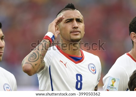 RIO DE JANEIRO, BRAZIL - June 18, 2014: Arturo VIDAL of Chile, during the FIFA 2014 World Cup. Spain is facing Chile in the Group B at Maracana Stadium - stock photo