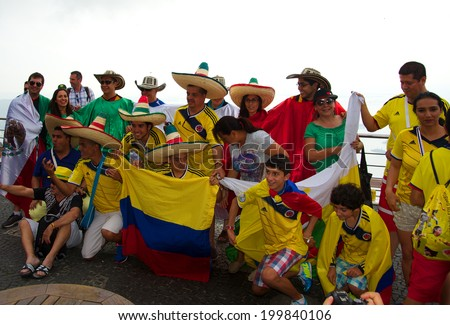 RIO DE JANEIRO, BRAZIL - JUNE 11: Colombian and Mexican soccer fans sharing their emotion at Sugar Loaf mountain (Pao de Acucar) one day before the FIFA World Cup started, on June 11, 2014.  - stock photo