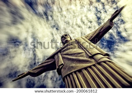 RIO DE JANEIRO, BRAZIL - JUNE 12: Dramatic shot of the Christ Redeemer at the Corcovado Hill, one of the most iconic landmarks of Rio de Janeiro, the day the FIFA World Cup began, on June 12, 2014 - stock photo