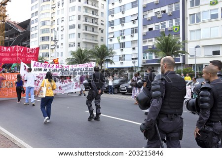 RIO DE JANEIRO, BRAZIL-June 23, 2014: Manifestation popular with domestic and international issues, followed closely by the Shock Battalion of the Military Police on Atlantic Avenue - Copacabana - stock photo