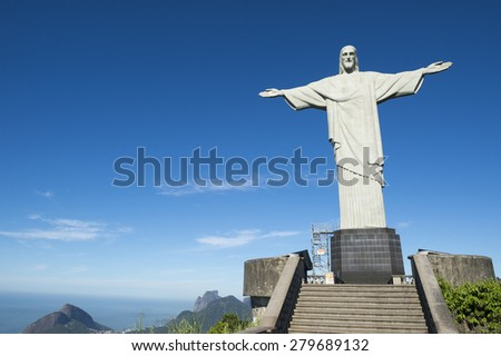 RIO DE JANEIRO, BRAZIL - MARCH 05, 2015: Statue of Christ the Redeemer stands above an empty viewing platform before the arrival of the first morning tram. - stock photo