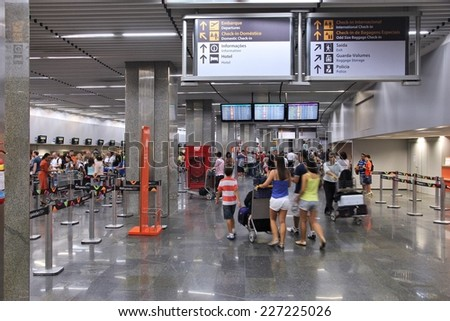 RIO DE JANEIRO, BRAZIL - OCTOBER 19, 2014: Travelers check in at Galeao airport of Rio de Janeiro. The airport served 17.1 million passengers in 2013. - stock photo