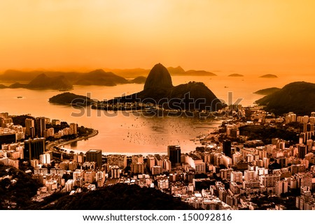 Rio de Janeiro, Brazil. Suggar Loaf and  Botafogo beach viewed from Corcovado mountain. Rio is second largest city of Brazil, and third largest metropolitan area and agglomeration in South America. - stock photo