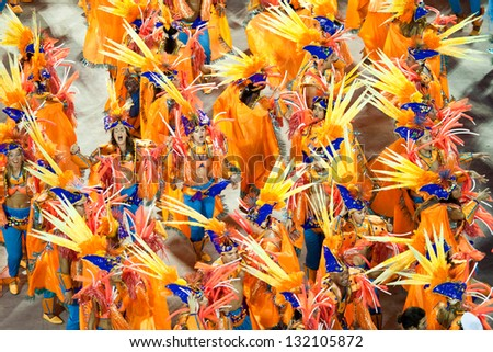 RIO DE JANEIRO - FEBRUARY 11: A woman in costume dancing on carnival at Sambodromo in Rio de Janeiro February 11, 2013, Brazil. The Rio Carnival is biggest carnival in world. - stock photo