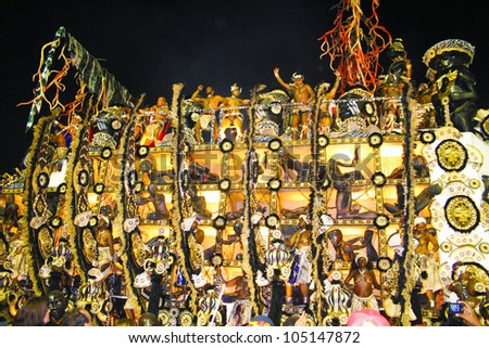 RIO DE JANEIRO - FEBRUARY 19:  Beija-Flor Samba School  carnival float  in Sambadome February 19, 2012 in Rio de Janeiro, Brazil. The Rio Carnival is the biggest carnival in the world. - stock photo