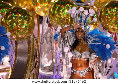 RIO DE JANEIRO - FEBRUARY 22: Samba dancer dressed up for the Rio Carnival in Sambadome February 22, 2009 in Rio de Janeiro, Brazil. The Rio Carnival is the biggest carnival in the world. - stock photo