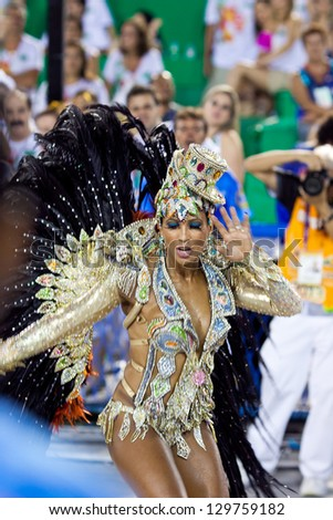 RIO DE JANEIRO - FEBRUARY 11: Samba dancer in costume singing and dancing on carnival at Sambodromo in Rio de Janeiro February 11, 2013, Brazil. The Rio Carnival is biggest carnival in world. - stock photo