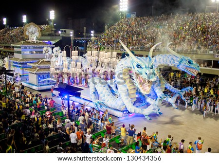 RIO DE JANEIRO - FEBRUARY 11: Show with decorations of dragons on carnival Sambodromo in Rio de Janeiro February 11, 2013, Brazil. The Rio Carnival is biggest carnival in world. - stock photo