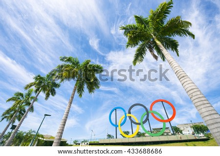 RIO DE JANEIRO - MARCH 18, 2016: Olympic rings stand next to tall palm trees in Parque Madureira Park, in Zona Norte, the North zone of the city.