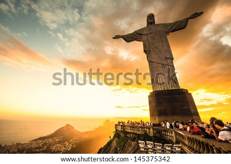 RIO DE JANEIRO, MARCH 3: Tourists are happy to see the first sunset after a week of rain and thunderstorms on the Corcovado Hill - march 3, 2013 in Rio de Janeiro, Brazil - stock photo
