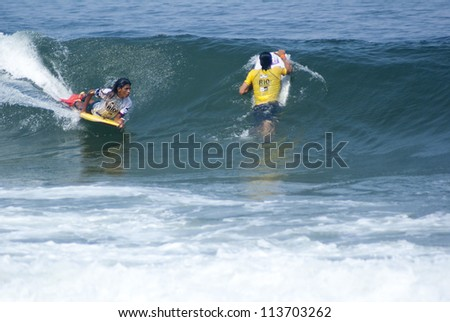 RIO DE JANEIRO - SEPT 11: Thomas Toledo and Joao Marcelo from Brazil perform during the event 2012 Rio Bodyboard International, September 11, 2012 in Rio de Janeiro, Brazil