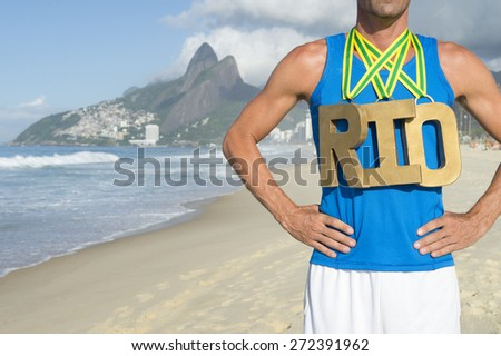 RIO first place athlete wearing gold medals standing outdoors on Ipanema Beach Rio de Janeiro Brazil  - stock photo