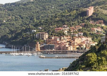 Rio Marina with harbor and watch-tower Torre dell'orologio, Elba, Tuscany, Italy, Europe - stock photo