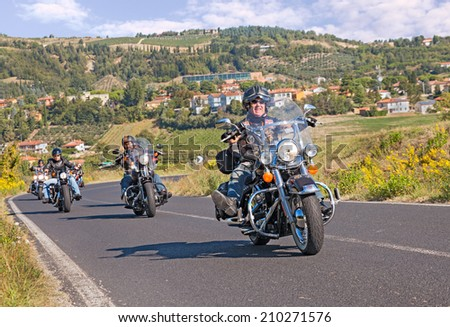 """RIOLO TERME, ITALY - SEPTEMBER 22: group of bikers riding american motorbike Harley Davidson at motorcycle rally """"Sangiovese tour"""" by Ravenna Chapter on September 22, 2013 in Riolo Terme, RA,Italy  - stock photo"""