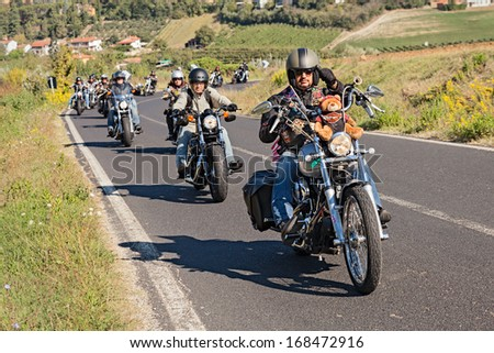 """RIOLO TERME, ITALY - SEPTEMBER 22: unidentified  bikers riding american motorbikes Harley Davidson at motorcycle rally """"Sangiovese tour"""" by Ravenna Chapter on September 22 2013 in Riolo Terme RA Italy - stock photo"""