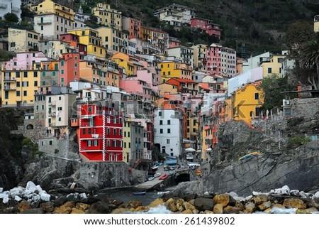 Riomaggiore ~ A beautiful village on rocky coast of Cinque Terre, Italy - stock photo