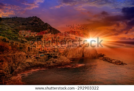 Riomaggiore fisherman village at sunset. Riomaggiore is one of five famous colorful villages of Cinque Terre