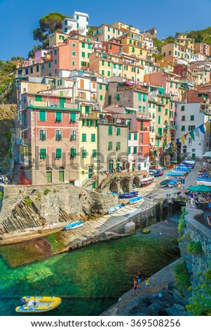 Riomaggiore is the first city of the Cique Terre sequence of hill cities, Liguria, Italy. It has a small dock that provides a good perspective of the shape imposed by the hills around the city.
