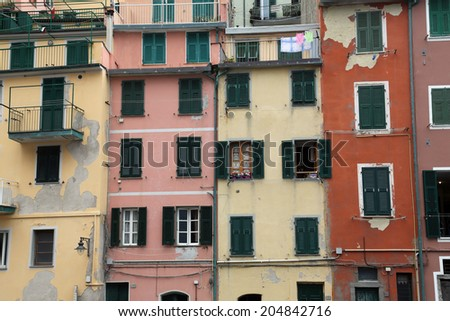 RIOMAGGIORE, ITALY - MAY 02: one of the Cinque Terre villages, UNESCO World Heritage Sites, remains a magnet for tourists to the famous Via dell'Amore remains closed, on May 02, 2014